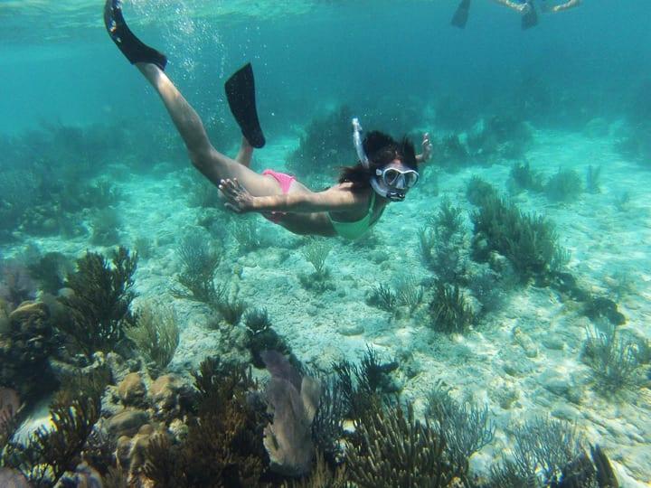 girl snorkeling belize