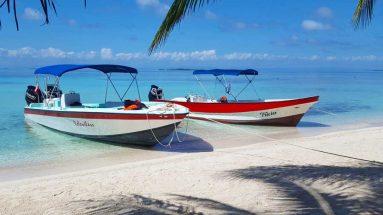 boats laughingbird caye